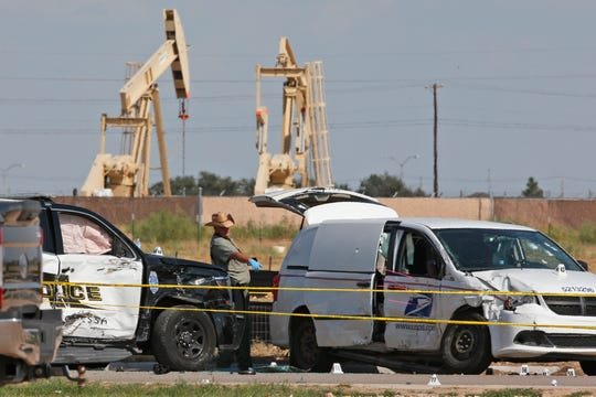 FILE - In this Sunday, Sept. 1, 2019, file photo, law enforcement officials process the crime scene from Saturday's shooting which ended with the shooter, Seth Ator, being shot dead by police in a stolen mail van, right, in Odessa, Texas.