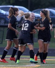 Corning's Ashlee Volpe, center, is congratulated by teammates after scoring the first goal of the game in a 2-0 win over Horseheads on Sept. 5, 2019 at Corning Memorial Stadium.