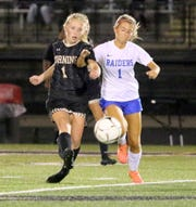 Corning's Ashlee Volpe, left, and Horseheads' Leah Karabaich battle for possession during the Hawks' 2-0 win in girls soccer Sept. 5, 2019 at Corning Memorial Stadium.