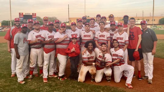 Bosse assistant Wade Conway (front row, center) poses with the Bulldogs.