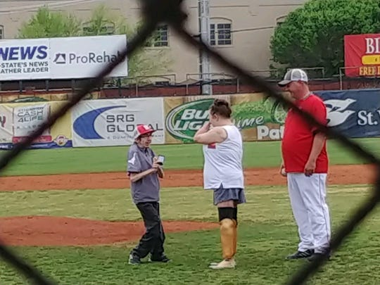 Not letting their disabilities get in the way, Wade Conway proposes marriage to Kendra Creek at Bosse Field.