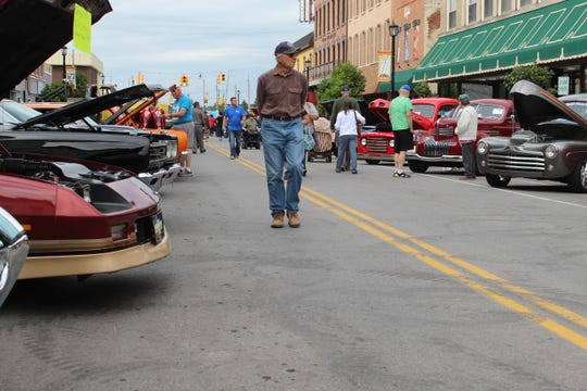Hundreds of residents visited Front Street to look at classic cars Friday night at Downtown Fremont, Inc.'s auto show.  The event also included the Wild Side Monster Truck, Oscar Mayer Weinermobile and several semi trucks.