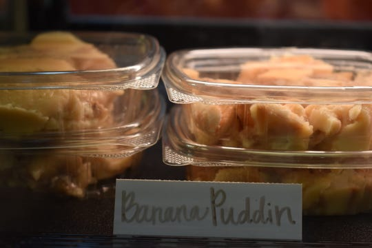 Containers of banana puddling sit inside the front display case at Plant to the Plate, a new southern restaurant that opened Aug. 27 in Fort Collins.