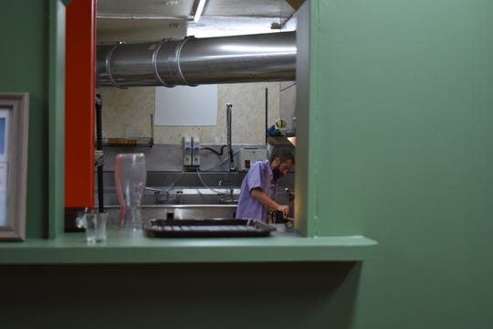 Plant to the Plate owner Robert Murry works in the kitchen of the new restaurant Friday morning, Sept. 6 in Fort Collins.