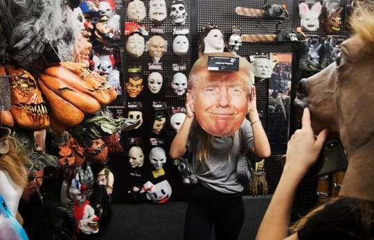 Hannah LaGrave, 16, center, and Madisyn Messier, 17, shop for Halloween masks on Thursday (9/5/19) at the Spirit Halloween pop-up store in Cape Coral. Spirit is one of several pop-up stores that receive heightened sales during the late summer and fall months.