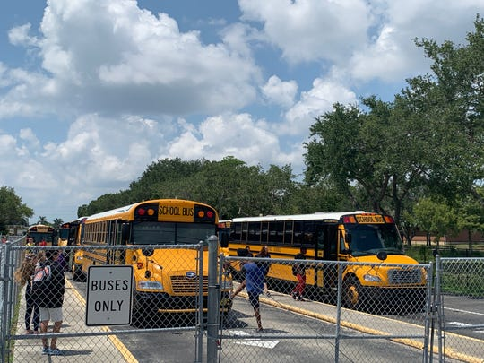 Students line up for the bus Friday, Sept. 6, 2019, at Cypress Lake High School in Fort Myers.