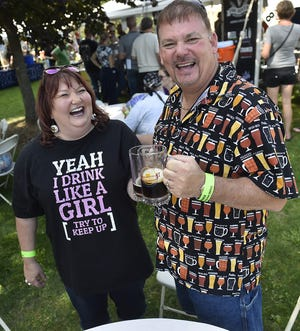 Mike and Kari Kamuda of Appleton dressed in their best beer tasting attire,for a past Egg Harbor AleFest. More than 130 craft brews, ciders and seltzers can be sampled at this year's festival Sept. 14.