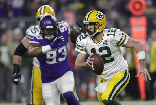 Green Bay Packers quarterback Aaron Rodgers (12) looks to pass on third down as he is pursued by Minnesota Vikings' Sheldon Richardson (93) in the first quarter during their football game Sunday, November 25, 2018, at U.S. Bank Stadium in Minneapolis, Minn.