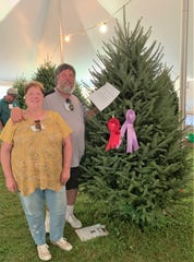 Mary and Dave Vander Velden of Oconto are seen Aug. 10 with their entry into the National Christmas Tree Association Contest in North Abington Township, Pennsylvania. The tree won Reserve Grand Champion, which earns the couple the right to provide a tree to the official residence of the Vice President next year.