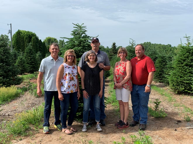 Yeska Brothers Farms of Wild Rose has purchased Whispering Pines Tree Farm in Oconto. The brothers and their wives, from left, are Ken and Carolann , Dan and Sharon, and Megan and Randy.