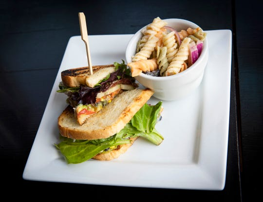Avocado sandwich with a side of pasta salad from Woodside Bistro in Greenville.
