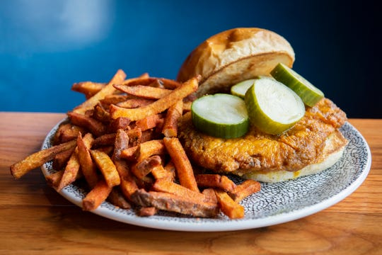 The crispy Greenville hot chicken sandwich and a side of sweet potato fried from The Burrow in Greenville.