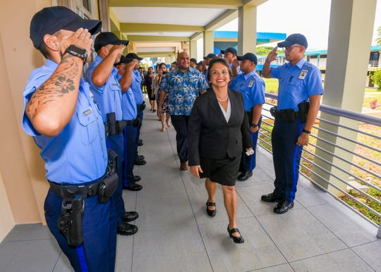 Gov. Lou Leon Guerrero and Lt. Gov. Josh Tenorio are rendered salutes by police officer trainees as they prepare to enter the latest building upgrade to the section of Guam Community College, formerly referred to as Building 100, in Mangilao on Friday, Sept. 6, 2019. The new building, which broke ground in September 2016, has been incorporated onto the west side of the Building E. The two-story, 17,849 square-foot addition that cost almost $5.2M to build, will house the institution's Criminal Justice and Developmental Education programs, as well as General Education classes, said John Dela Rosa, GCC Communications & Promotions assistant director.
