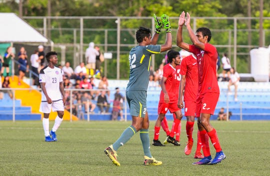 Maldives players celebrate after clinching a victory over the Matao during a Round 2 match of the preliminary qualification for the FIFA World Cup Qatar 2022 and AFC Asian Cup China 2023 at the Guam Football Association Training Center in Dededo Sept. 5. The Maldives won 1-0.