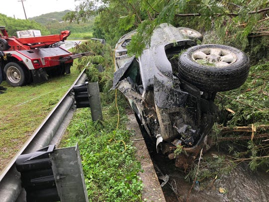 A tow truck works to remove a vehicle that crashed along Route 4 near Pago Bay.