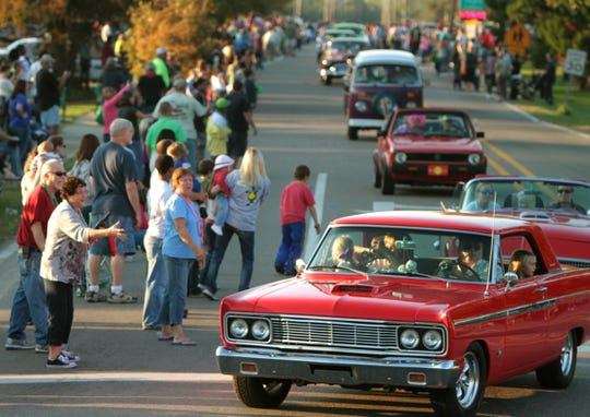Spectators line Cleveland Avenue in 2012 to watch the classic cars roll in Cruisin' The Coast parade in Long Beach. The parade takes place Oct. 7 this year.