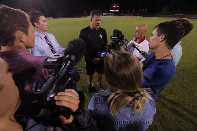 Todd Yeagley, head coach, talks with media members after Indiana University's men's soccer 3-2 win over Pittsburg in the IU Classic, Bloomington, Friday, Aug. 30, 2019. The program, mostly helmed by Jerry Yeagley and his son Todd, have been the nation's most successful since the program's inception in 1973.