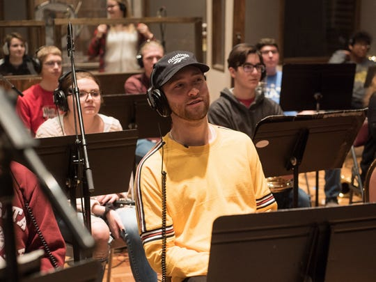 Kid Quill sits with Shelbyville High School band musicians during a February recording session in Indianapolis.