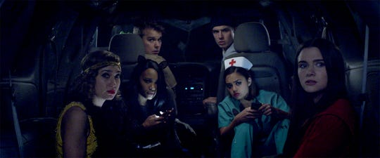 (L-R) Schuyler Helford as Mallory, Lauryn Alisa McClain as Bailey, Andrew Caldwell as Evan, Will Brittain as Nathan, Shazi Raja as Angela, and Katie Stevens as Harper in the horror / thriller HAUNT, a Momentum Pictures release.