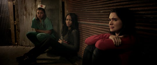 (L-R) Shazi Raja as Angela, Lauryn Alisa McClain as Bailey, and Katie Stevens as Harper in the horror / thriller HAUNT, a Momentum Pictures release.