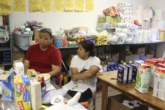 Yolanda Soto (left) and Dorcas Diego sit at Trinity Mission Center in Forest on Aug. 21, 2019. They are helping to coordinate donations for families impacted by immigration raids that took place on Aug. 7, 2019.