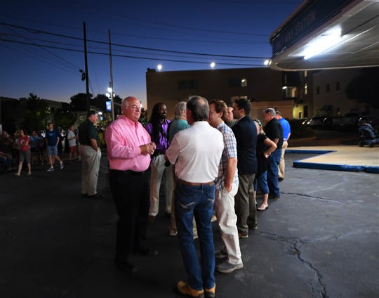 John Allen, left, talks to Madison County Mayor Jimmy Harris before lighting up the fresh neon on the Jackson Greyhound bus station Sept. 5, 2019. Allen purchased the station in October 2018.