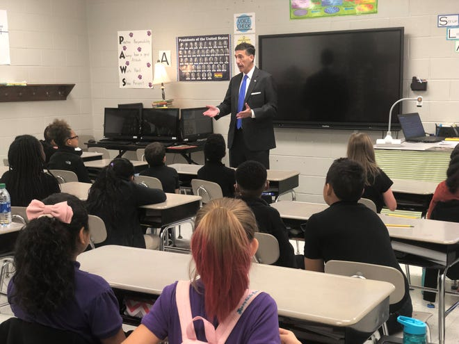 Congressman David Kustoff talks to Samantha Bremer's fifth grade class at Thelma Barker Elementary Thursday morning before reading to them.