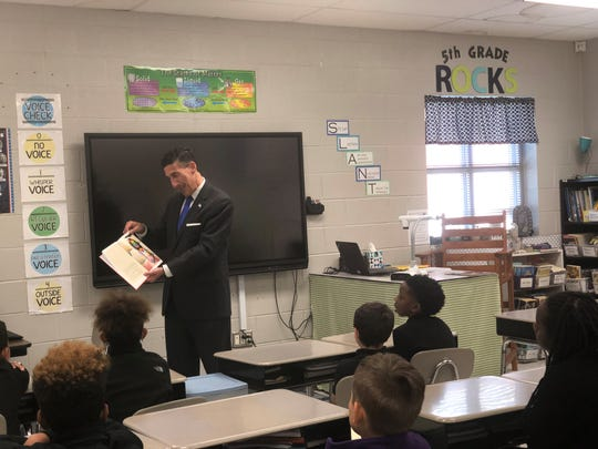 "Congressman David Kustoff reads ""A Bad Case of Stripes"" to Samantha Bremer's fifth grade class at Thelma Barker Elementary on Thursday morning."