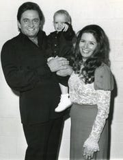June and Johnny Cash — here with son John Carter Cash — performed at the Dogwood Arts Festival in 1971.