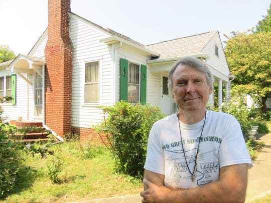 Pond Gap advocate David Williams stands in front of old ancestral home at 3703 Sutherland Ave. on Sept. 4.