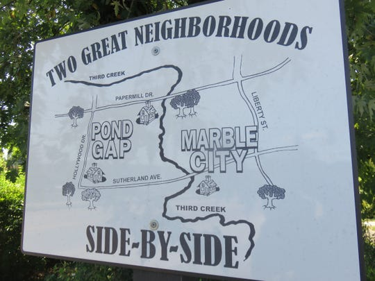 Historic sign telling about Pond Gap and Marble City.