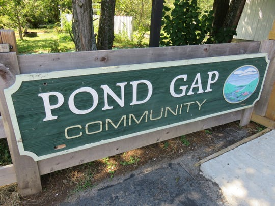 Pond Gap community sign by Stock Burgers.