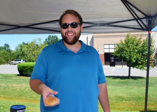 Choir Director Seth Tinsley personally baked cookies to increase sales during the car wash fundraiser sponsored by Karns High School Choir and held at Advance Auto Parts Saturday, Aug. 31.