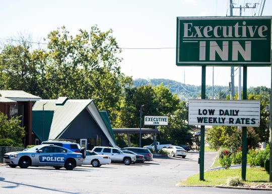 The scene at the Executive Inn at 3400 Chapman Highway in Knoxville after shots were fired as Knoxville police attempted to serve a warrant on Friday, Sept. 6, 2019.