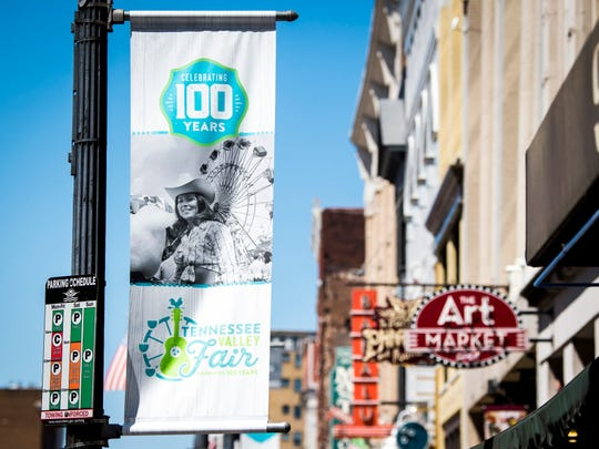 A Tennessee Valley Fair banner featuring a 1973 News Sentinel photo of Diane Whitt at the fair hangs on Gay St. in downtown Knoxville on Friday, Sept. 6, 2019.