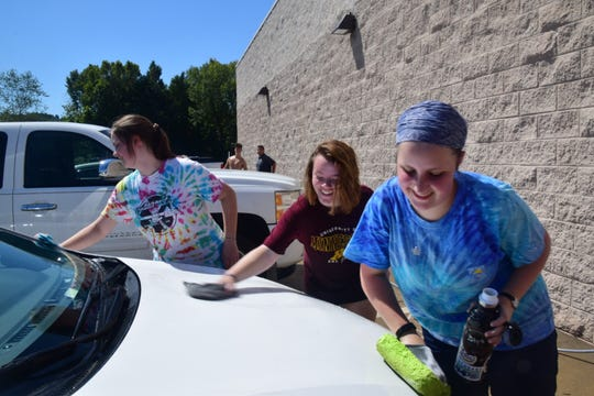 Jeanne Seibel, 15, Jaden Howell, 16, and Emily Seibel, 15, make quick work of washing a car. 8/31/19
