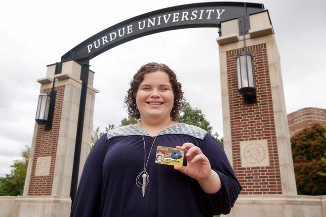 PHOTO ILLUSTRATION -- Emily Jones poses for a photo with a new Purdue student ID that features an expiration date that allows the ID card to be used as a voter ID, Friday, Sept. 6, 2019 in West Lafayette.