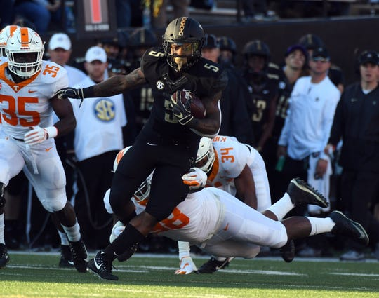 Nov 24, 2018; Nashville, TN, USA; Vanderbilt Commodores running back Ke'Shawn Vaughn (5) runs for a first down during the first half against the Tennessee Volunteers at Vanderbilt Stadium. Mandatory Credit: Christopher Hanewinckel-USA TODAY Sports