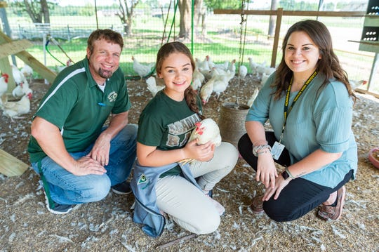 Wayne Oubre, Kennedy Pellerin, and Allison Guynn, pictured in the Acadiana High School chicken coop on Thursday, Sept. 5, 2019.