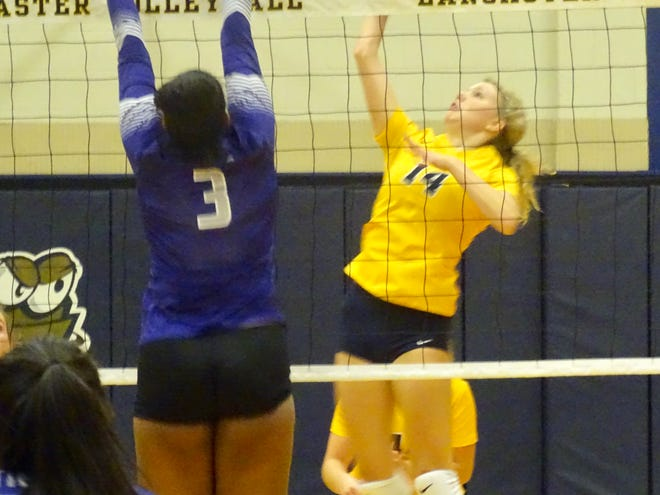 Lancaster sophomore Ansley Baker hits the ball over the net against Pickerington Central Thursday night. The Gales swept the Tigers.