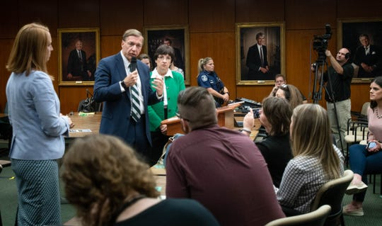 New Michigan State University President Samuel Stanley addresses members of the press following the first MSU Board of Trustees meeting, Friday, Sept. 6, 2019, in the Hannah Administration building.  Beside Stanley looking on is Trustee Diane Byrum.