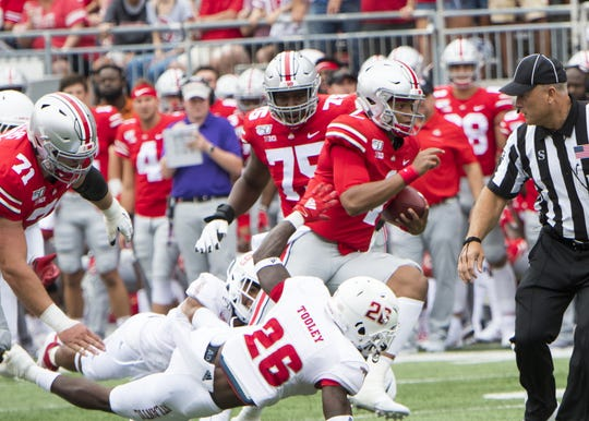 Ohio State quarterback Justin Fields surges through the line for a 51-yard touchdown on the fourth play from scrimmage in last Saturday's 45-21 win over Florida Atlantic