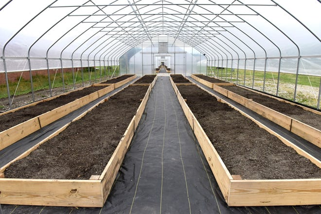 Four new microfarms were unveiled Friday evening at the Gorman-Rupp property off Bowman Street near the intersection with West Sixth Street.