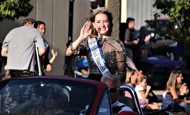 Miss Popcorn 2019 Payton Baxter leads a long line of festival royalty down Center Street during the Marion Popcorn Festival Parade.