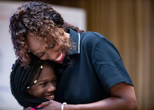 Olympic Gold Medalist Jackie Joyner hugs a Cummings K-8 School student during the Comcast eligibility expansion announcement Friday, September 6, 2019.