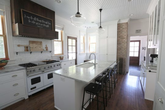 The completely redone kitchen includes custom-made cabinets, tile to the ceiling, a Viking oven and quartzite countertop. Travis Kreger built the hood vent over the stove.
