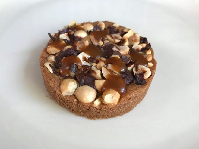 A hazelnut cookie with chocolate and caramel is one of the simpler items in the pastry case at Odyssey Patisserie, 222 E. Erie St. It's inside Char'd, the modern Korean restaurant.