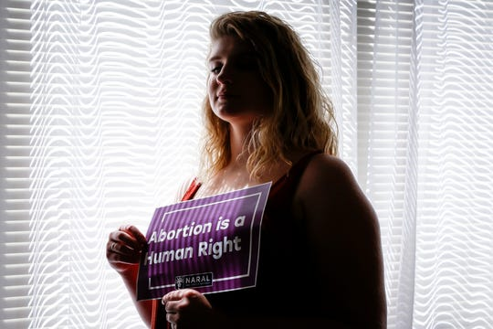 Beth Vial, who didn't learn she was pregnant until 26 weeks after chronic medical conditions masked her symptoms, poses for a portrait at her home in Portland, Ore. Vial was beyond the point when nearly every abortion clinic in the country would perform the procedure. Her only option for an abortion was New Mexico.