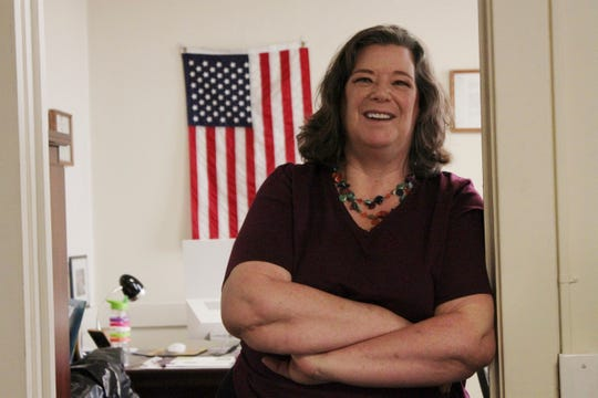 Joan Lamunyon Sanford, executive director of the New Mexico Religious Coalition for Reproductive Choice, poses for a photograph in her office in Albuquerque, N.M. The group helps an average of 100 women a year but is on track to assist 200 this year.