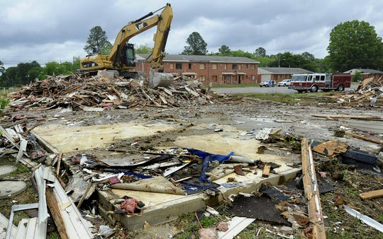 City crews begin the demolition of the dilapidated Gardens of Cloverland apartments Monday in west Montgomery, after years of setbacks with the owner of the property.